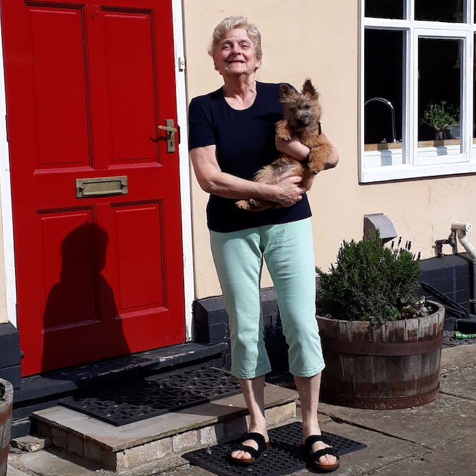 Picture of my mother and our dog, Otto, outside her new house in Hadleigh