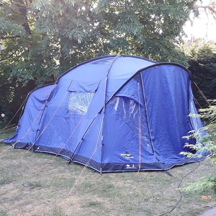 Picture of our blue family tent pitched in the garden