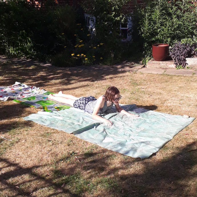 Pic of my daughter sliding along a home made slip n slide
