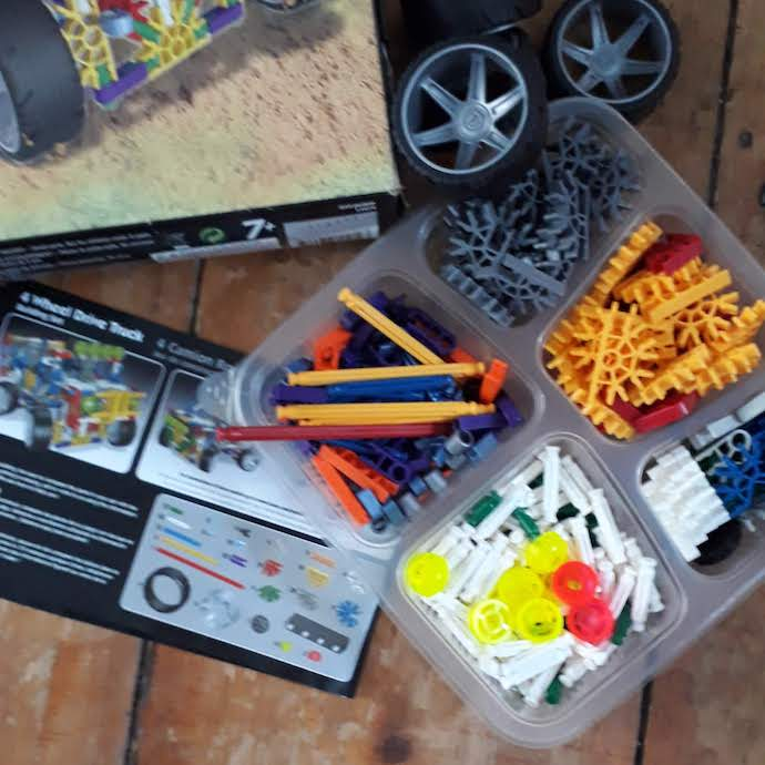 Picture of K'nex pieces and instructions for my post on frugal summer holiday activities for kids