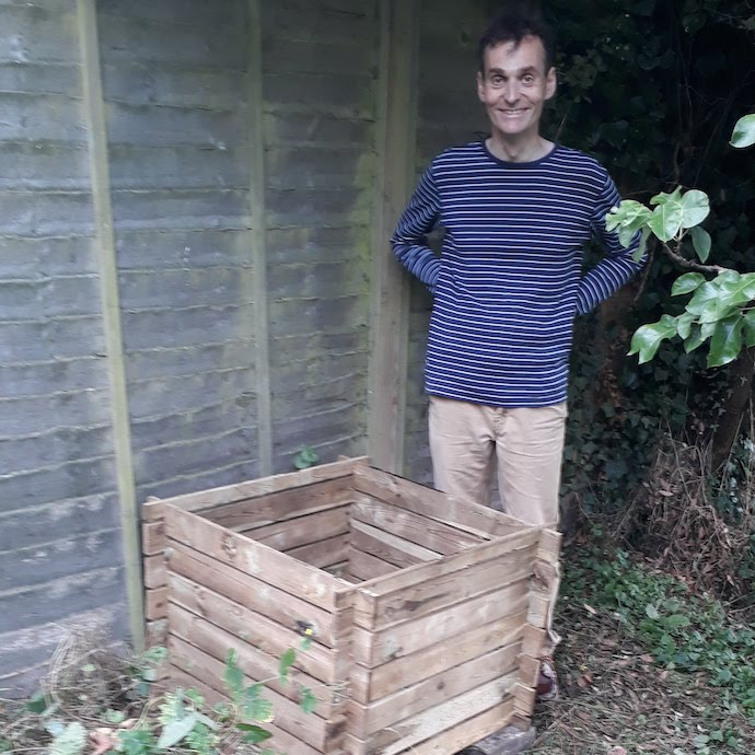 Picture of my husband after he'd put our compost bin together