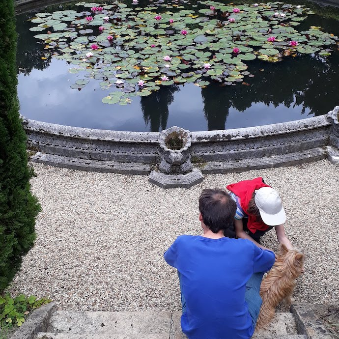 Picture of my husband, daughter and dog by the lily pond at Belvoir Castle