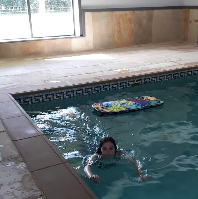 Picture of my daughter in the pool at our holiday cottage