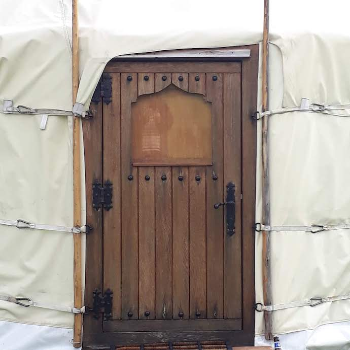Picture of our wooden front door when staying in a yurt