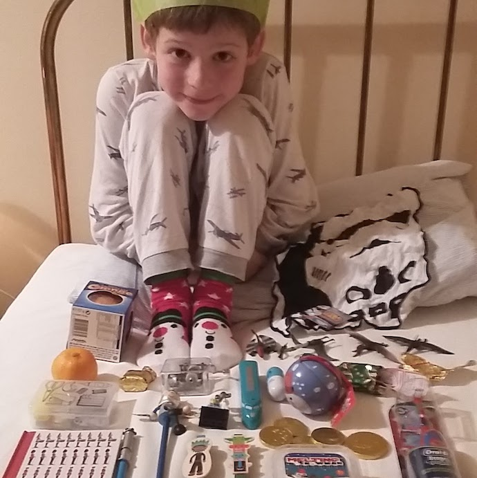 Pic of my son and the contents of his cheap but fun stocking