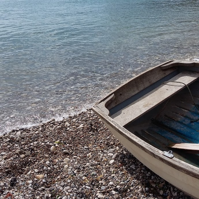 Picture of a boat pulled up on a beach, as the holiday of a lifetime
