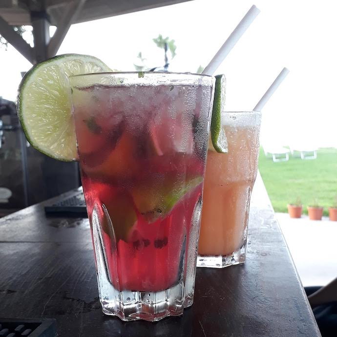 Picture of a couple of cocktails on a bar, for my post on how to socialise on a budget