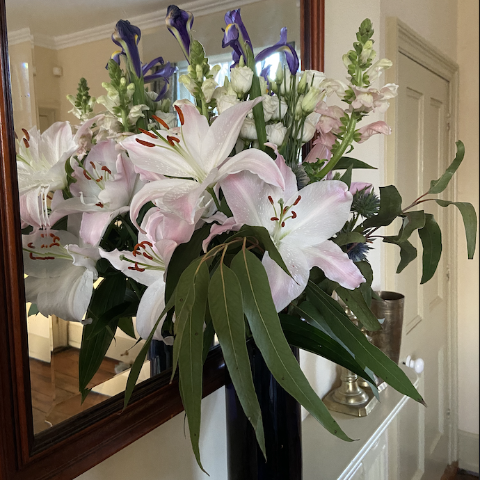 Picture of a bouquet on Freddies Flowers, including lilies and eucalyptus