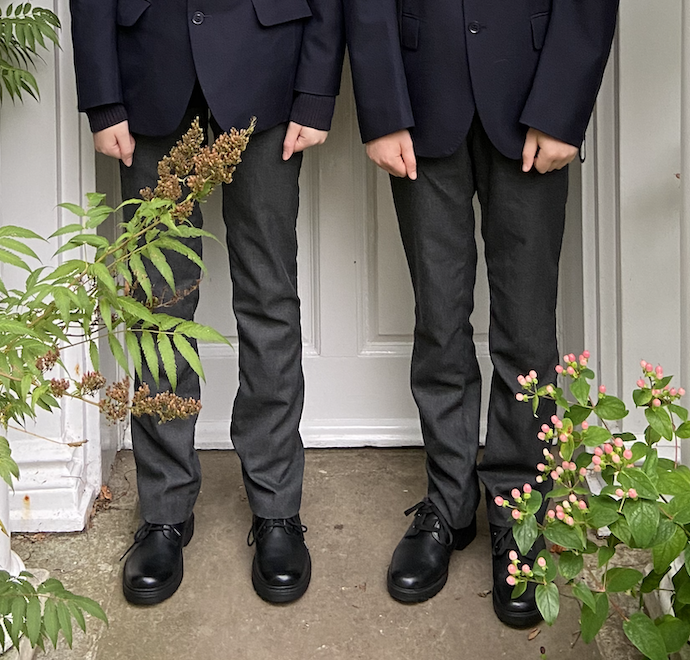 Picture of arms, legs and shoes of my two in their school uniform