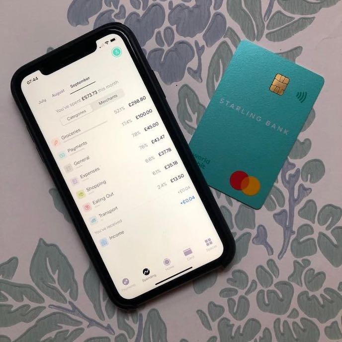 Picture of my Starling Bank debit card and app open to show budgeting categories