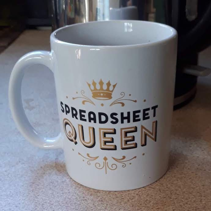 Picture of my spreadsheet queen mug