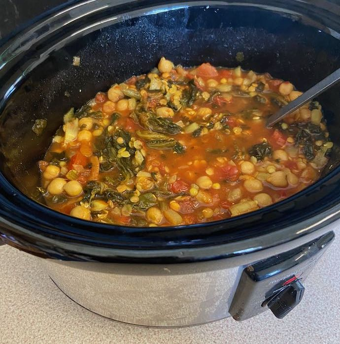 Picture of chicken chickpea and spinach soup in a slow cooker